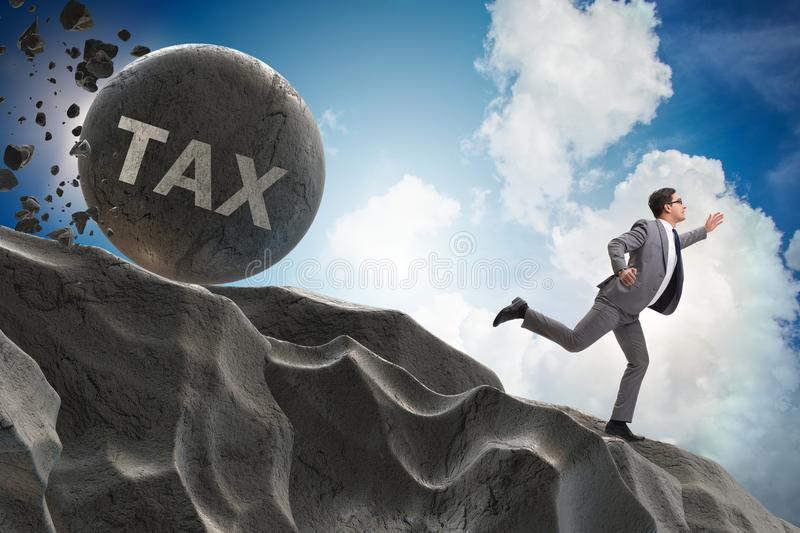 The businessman in high taxes business concept. Businessman in high taxes business concept royalty free stock images