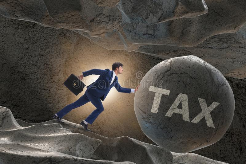 The businessman in high taxes business concept. Businessman in high taxes business concept royalty free stock photos