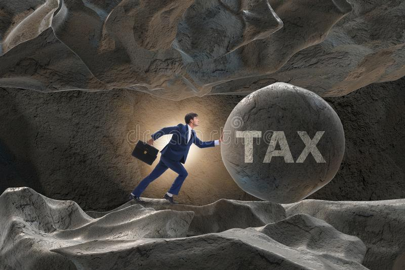 The businessman in high taxes business concept. Businessman in high taxes business concept stock photos