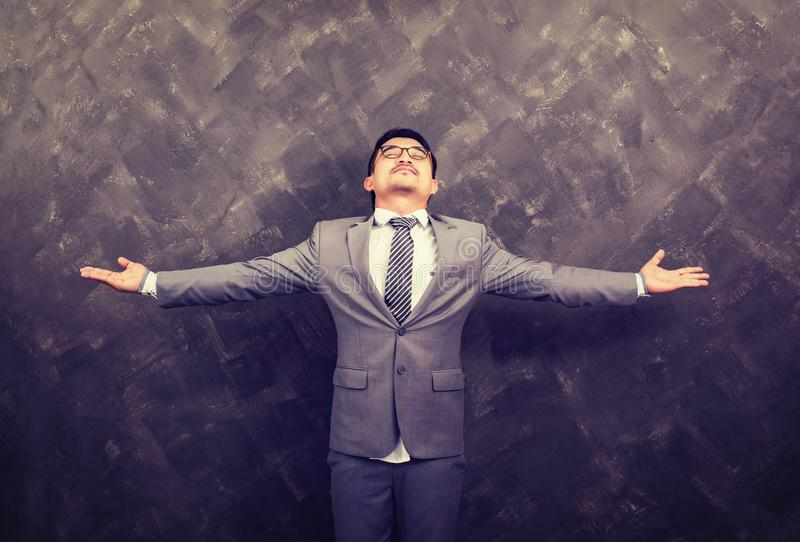 Businessman with his arms wide open on the grunch stock photos