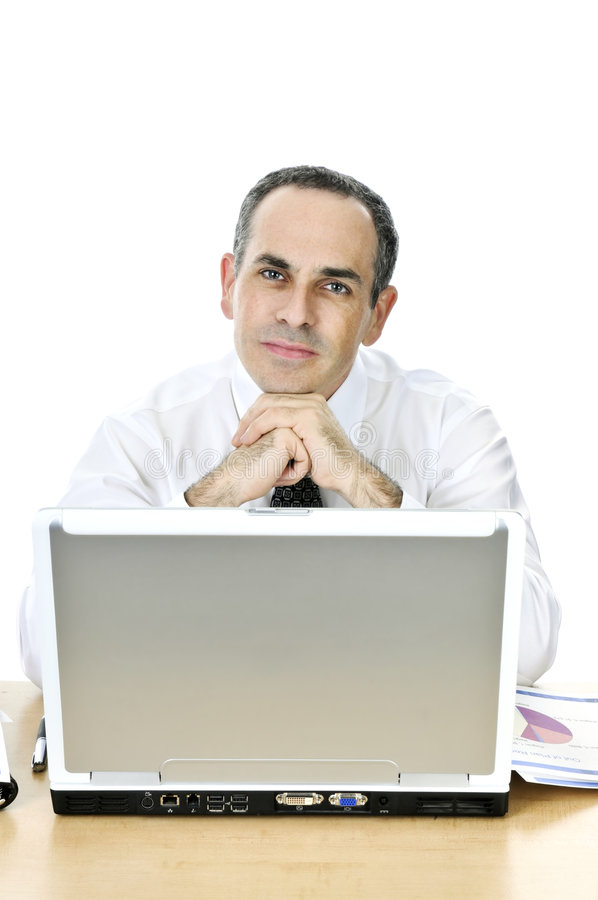 Businessman at his desk on white background stock image