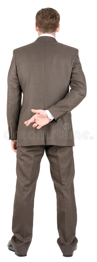 Businessman with his fingers crossed stock photography