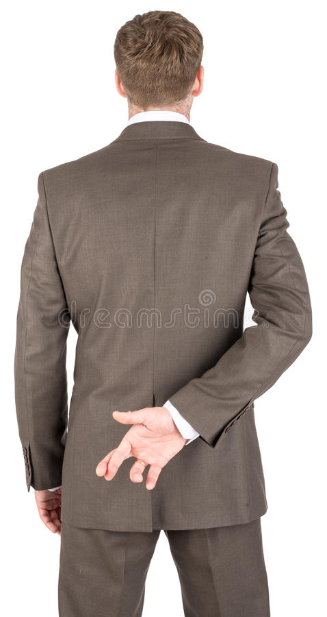 Businessman with his fingers crossed stock photos
