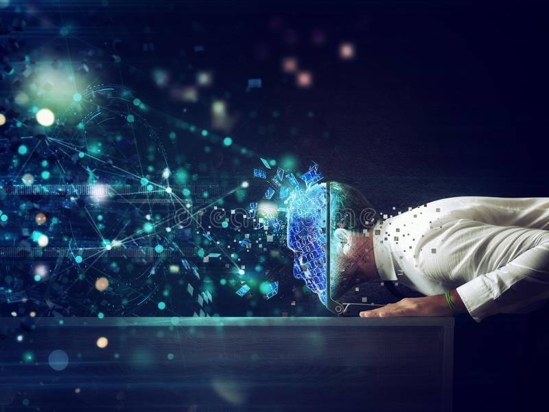 Businessman with his head inside a cyberspace through the laptop. Internet connection and addiction concept stock photos