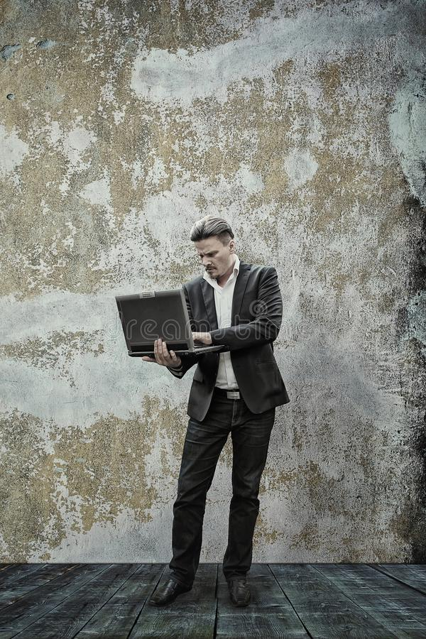 Businessman and His Laptop royalty free stock photos