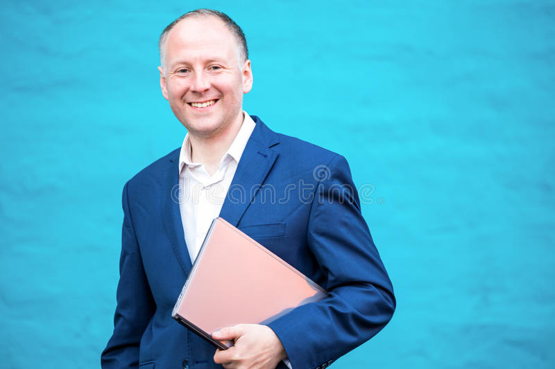 Businessman with his laptop stock photography