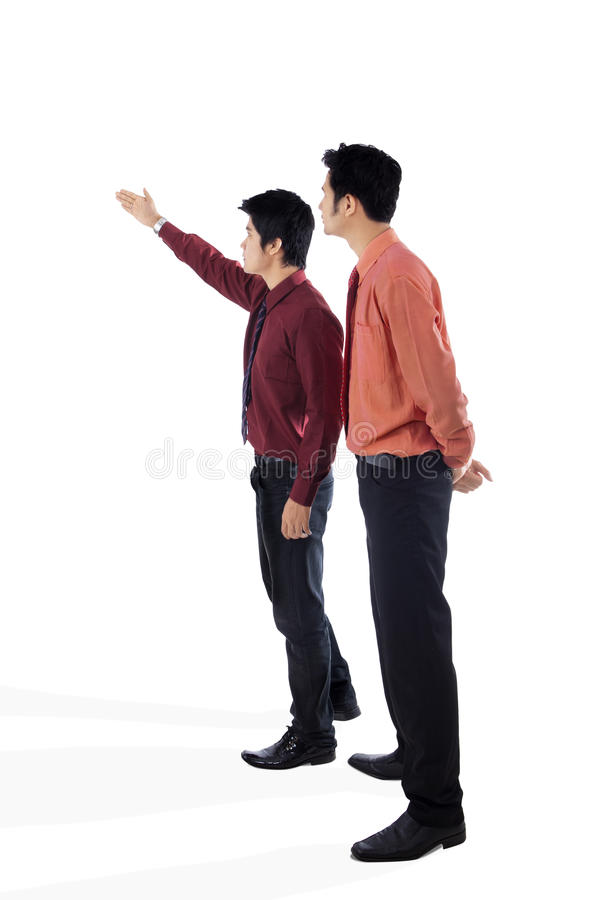 Businessman and his manager. Businessman showing something to his manager/supervisor on white background royalty free stock photos