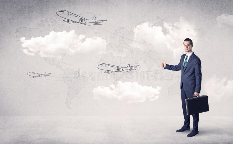 Businessman hitchhiking with airplanes around royalty free stock photography