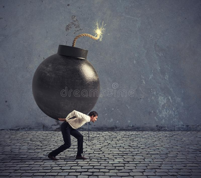 Businessman hold a bomb. Concept of difficult career and failure. Businessman hold a big bomb. Concept of difficult career and failure stock photo