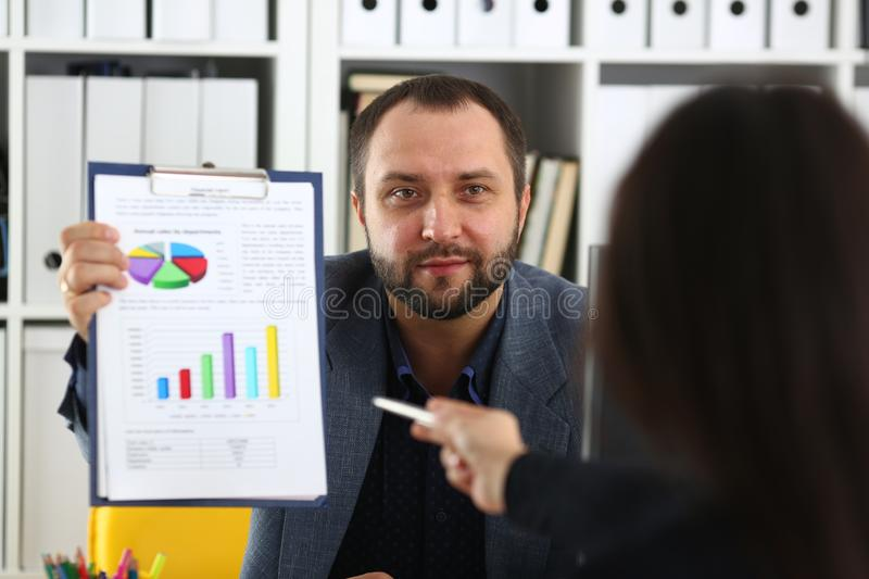 Businessman hold binder in his arms discuss with his partner their future project stock images