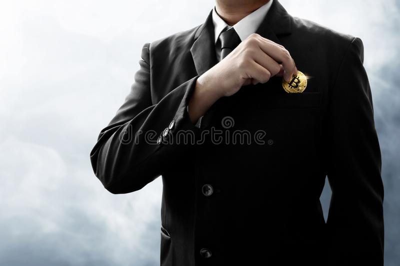 Businessman holding bitcoin on smoke background. Businessman hold bitcoin on smoke background royalty free stock image