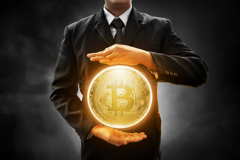 Businessman hold bitcoin on smoke background. Businessman holding bitcoin on smoke background stock images