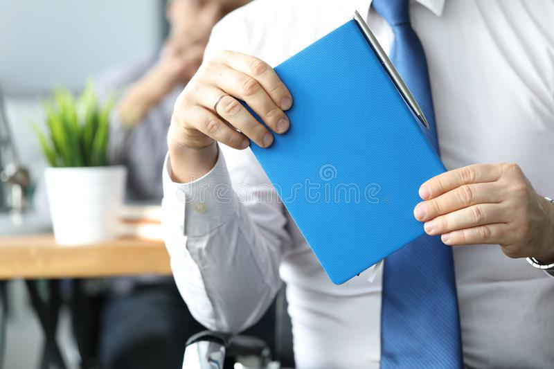 Businessman hold blue diary in hand. Business education concept royalty free stock photography