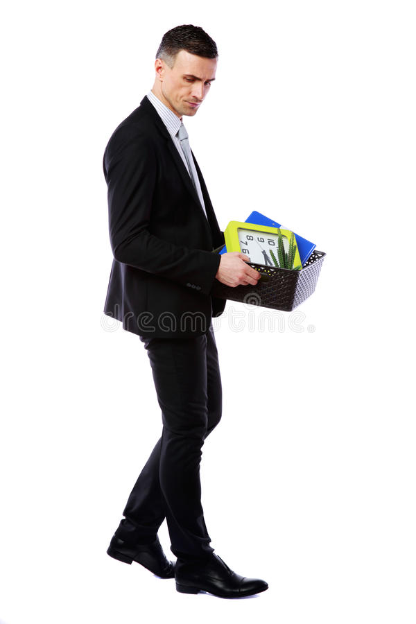 Businessman hold box with personal belongings. You are fired! Businessman hold box with personal belongings isolated on white background royalty free stock photos