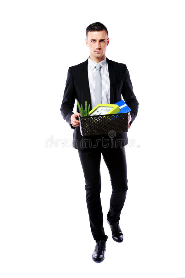 Businessman hold box with personal belongings. You are fired! Businessman hold box with personal belongings isolated on white background royalty free stock images