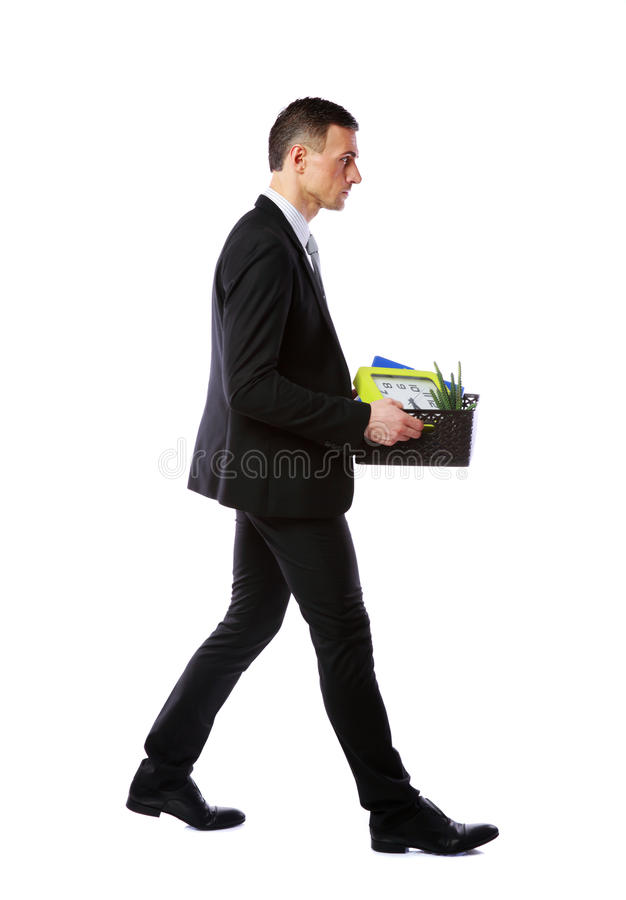 Businessman hold box with personal belongings. You are fired! Businessman hold box with personal belongings isolated on white background stock images