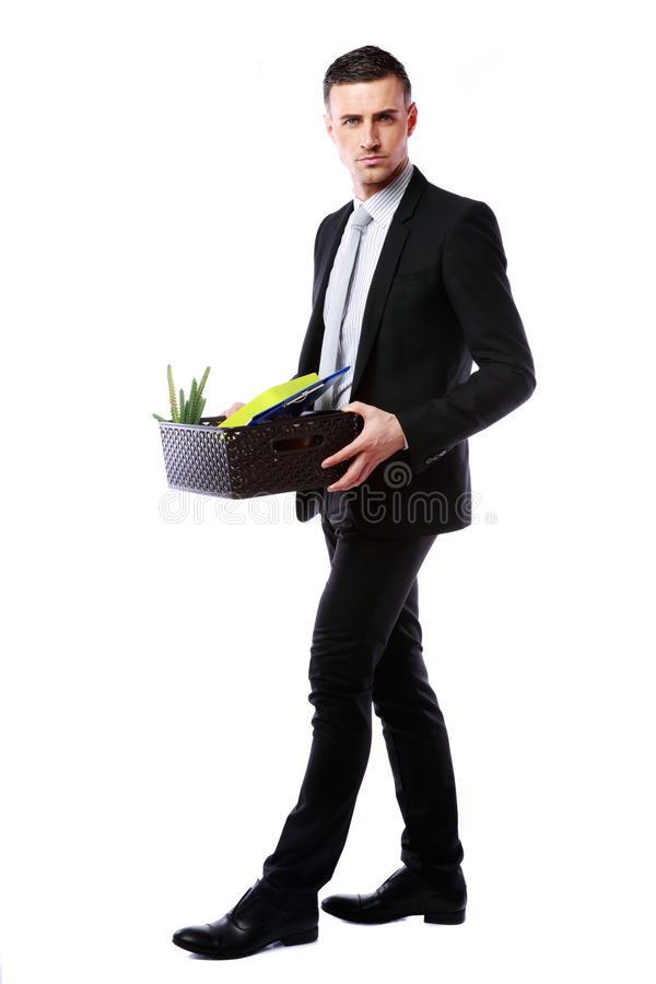 Businessman hold box with personal belongings. You are fired! Businessman hold box with personal belongings isolated on white background stock photography