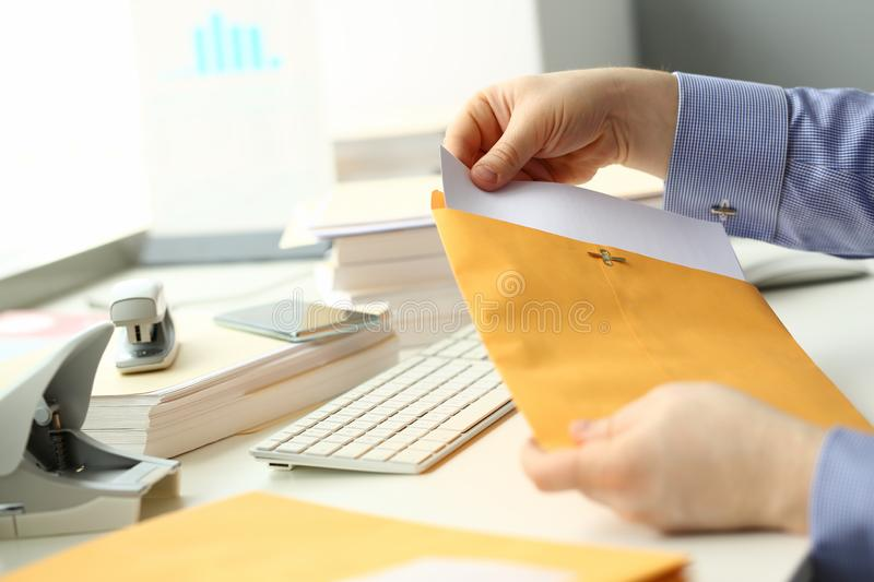 Businessman hold hand yellow mail envelope stock photo