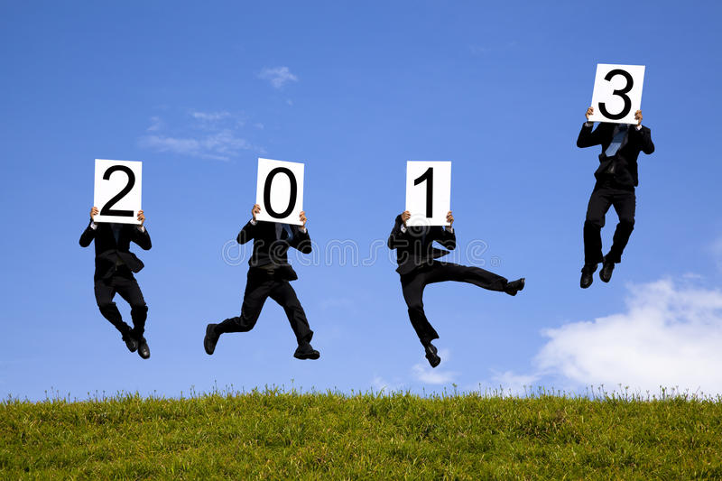 Businessman holding 2013 new year text stock photos