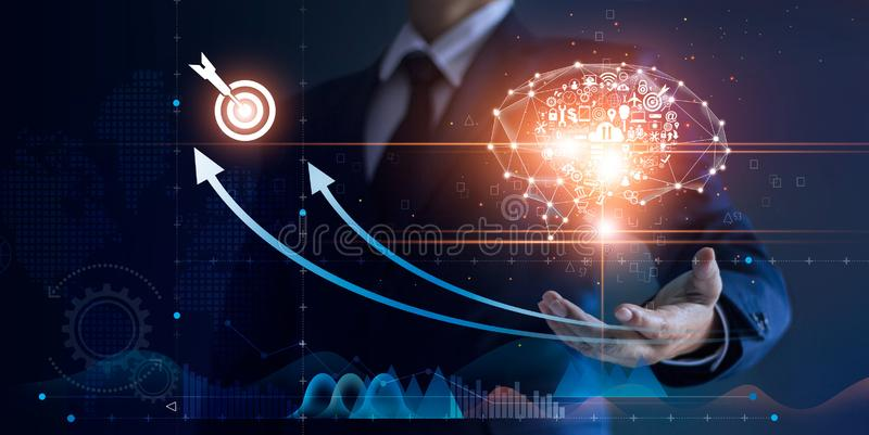 Businessman holding abstract brain and icon digital marketing, strategy and growtn investment. Business target goal, media and technology royalty free stock photos
