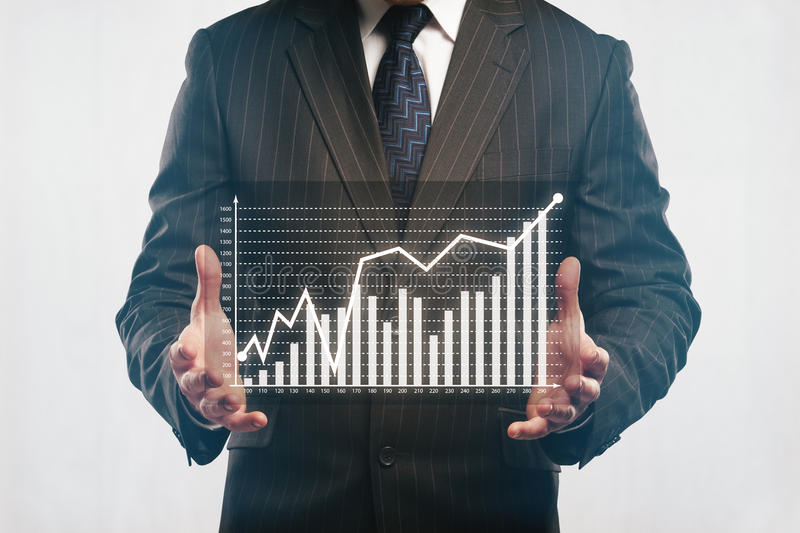Businessman holding abstract business diagram stock photo