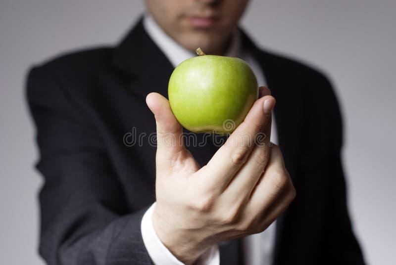 Businessman holding apple stock photo