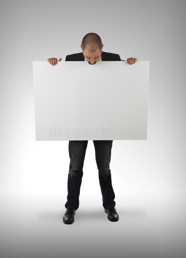 Businessman holding a big card. Isolated on white stock images