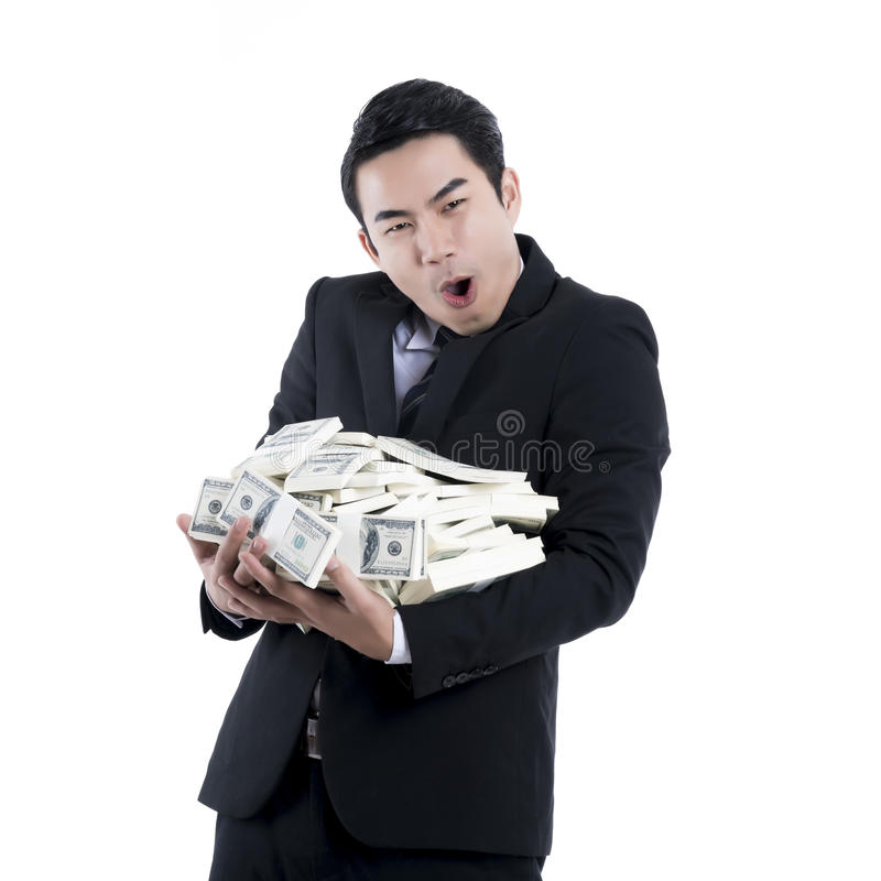 The Businessman holding a big pile of money in his arms on white royalty free stock image