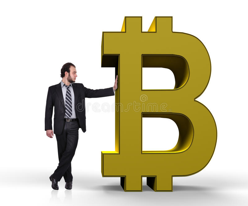 Businessman holding bitcoin. Businessman holding golden symbol of bitcoin stock photos