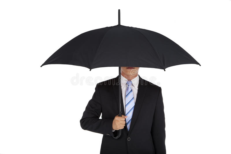 Businessman holding black umbrella stock photo