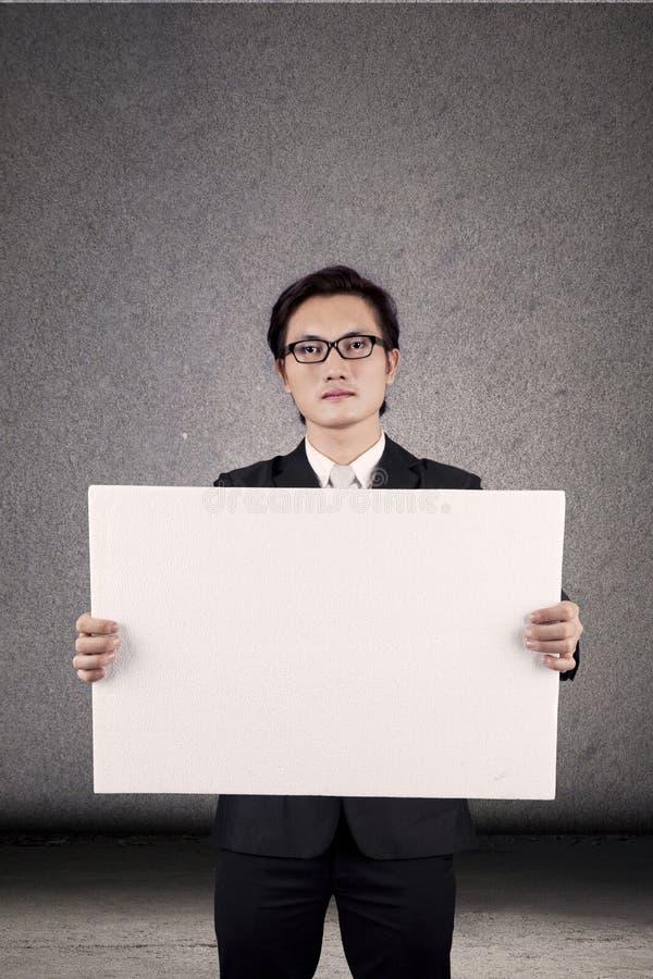 Download Businessman Holding Blank Banner Stock Image - Image: 25804973