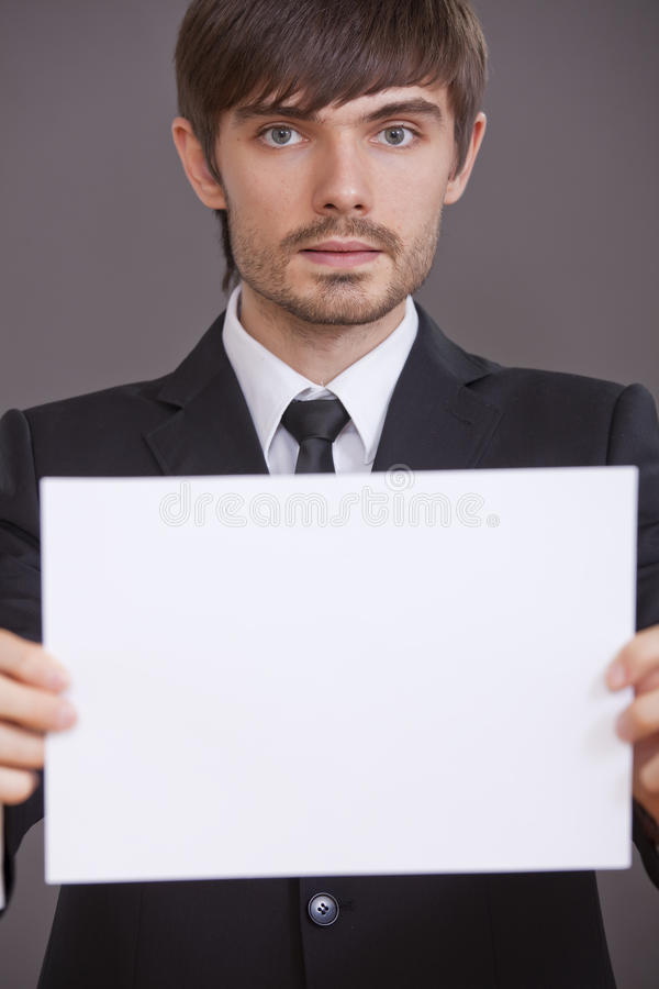 Download Businessman Holding Blank Board Stock Image - Image of card, young: 15441931