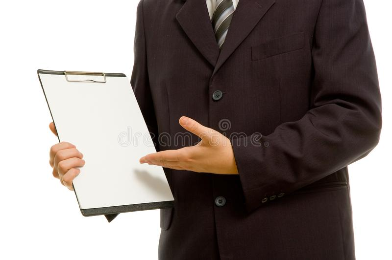 Businessman holding a blank clipboard royalty free stock photography