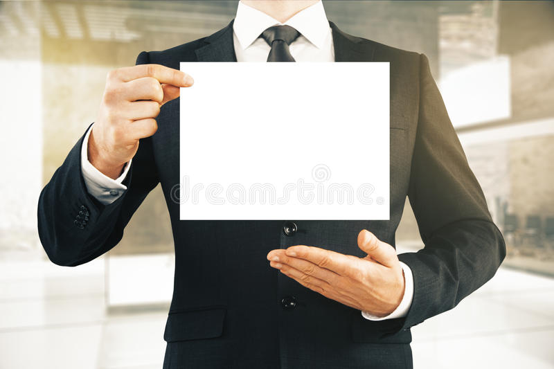Businessman holding blank paper stock illustration