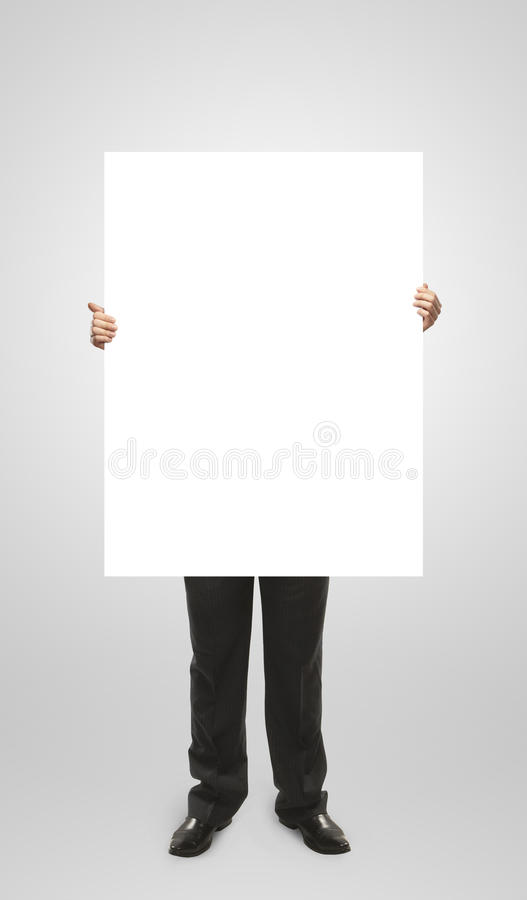 Businessman holding a blank white board. stock photography