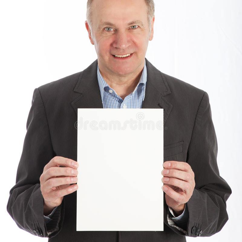 Download Businessman Holding Blank White Card Stock Image - Image: 25847921