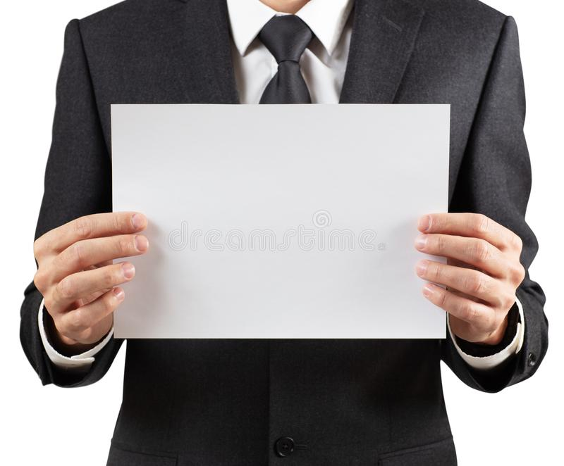 Businessman holding a blank white sheet for text space. Isolated on white royalty free stock photos