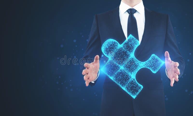 Businessman holding blue puzzle stock photo