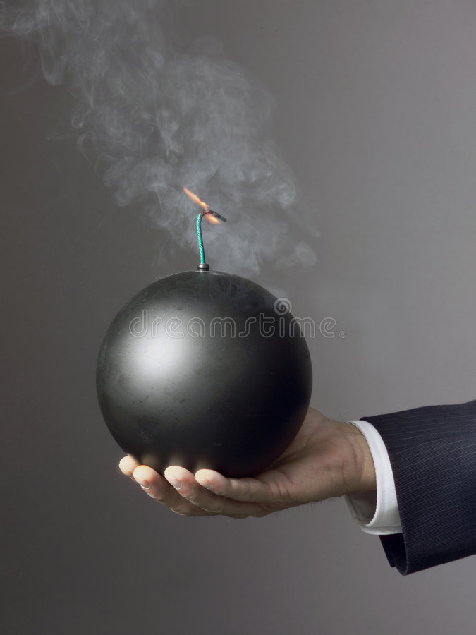 DEADLINE BUSINESS STRESS, TIME RUNNING OUT, BUSINESSMAN HOLDING BOMB GREED royalty free stock photography