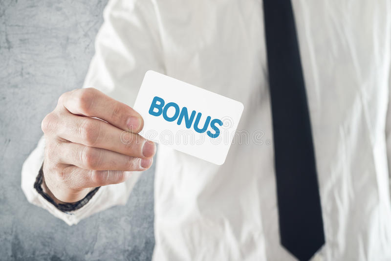 Businessman holding Bonus card. stock photography