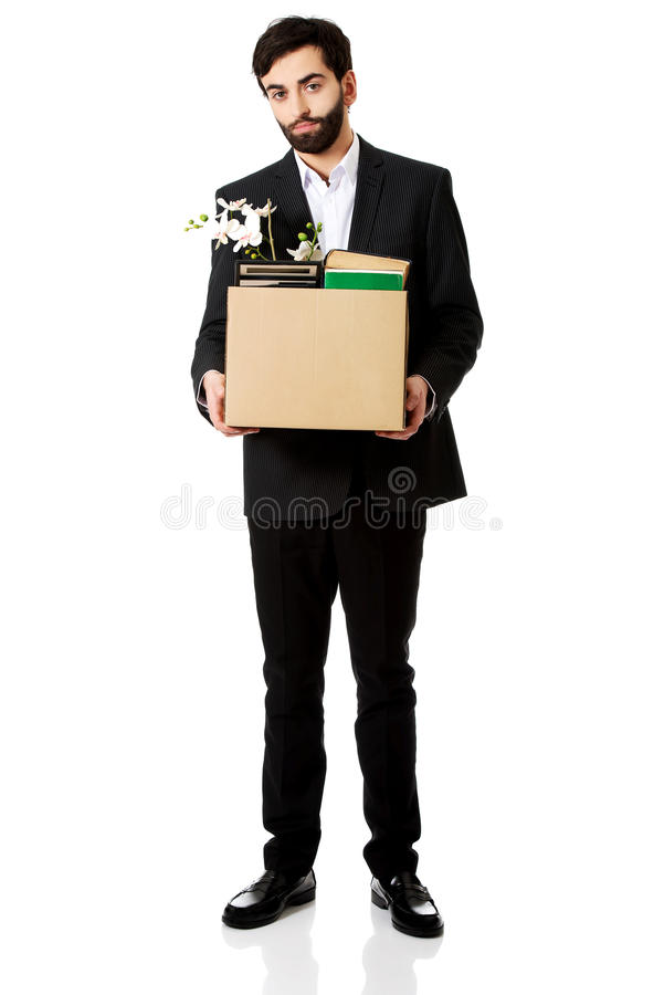 Businessman holding box with personal belongings. Fired businessman holding box with personal belongings stock images