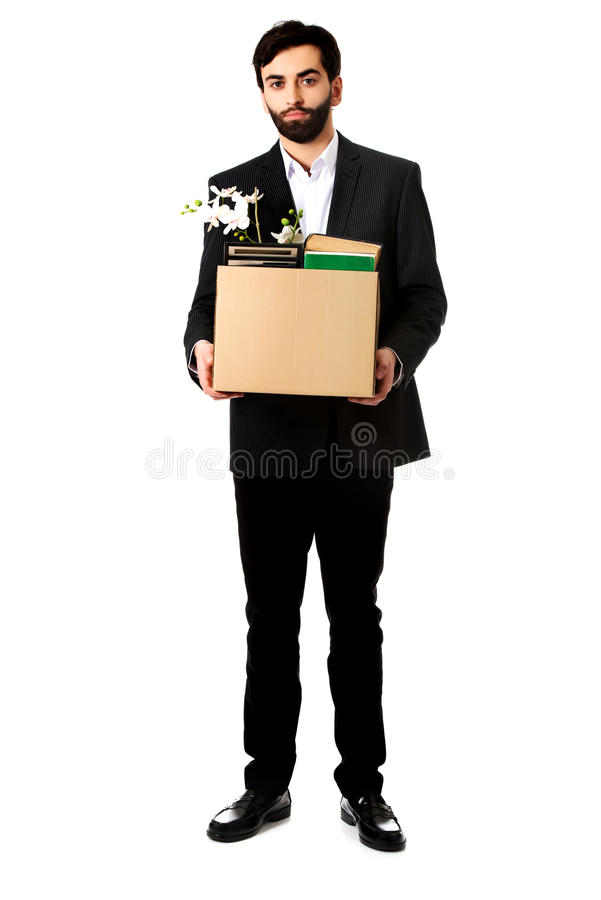 Businessman holding box with personal belongings. Fired businessman holding box with personal belongings stock image