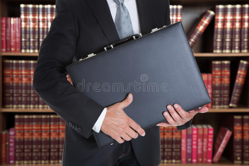 Businessman Holding Briefcase In Office stock image