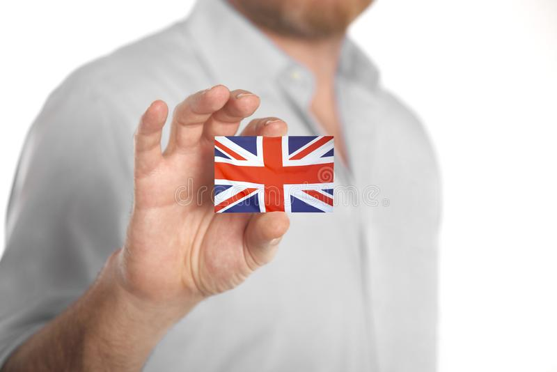 Businessman holding business card with United Kingdom flag stock images