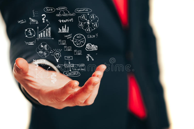 Businessman holding a business plan diagram stock image