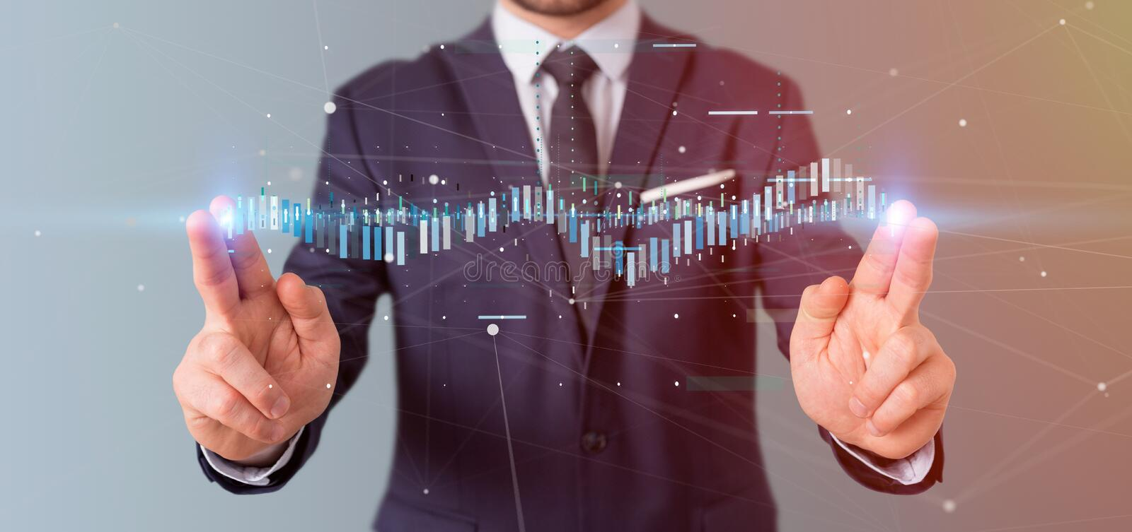 Businessman holding a Business stock exchange trading data information. View of a Businessman holding a Business stock exchange trading data information stock photography