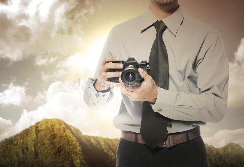 Businessman holding the camera on his hand royalty free stock images