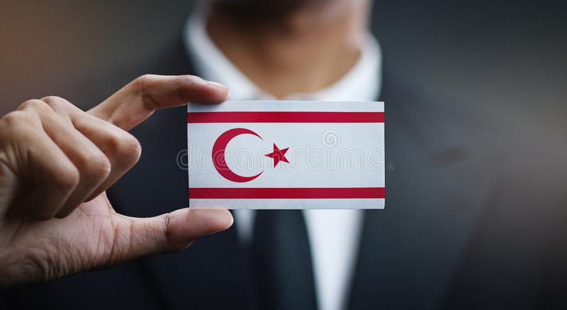 Businessman Holding Card of Northern Cyprus Flag.  royalty free stock photos