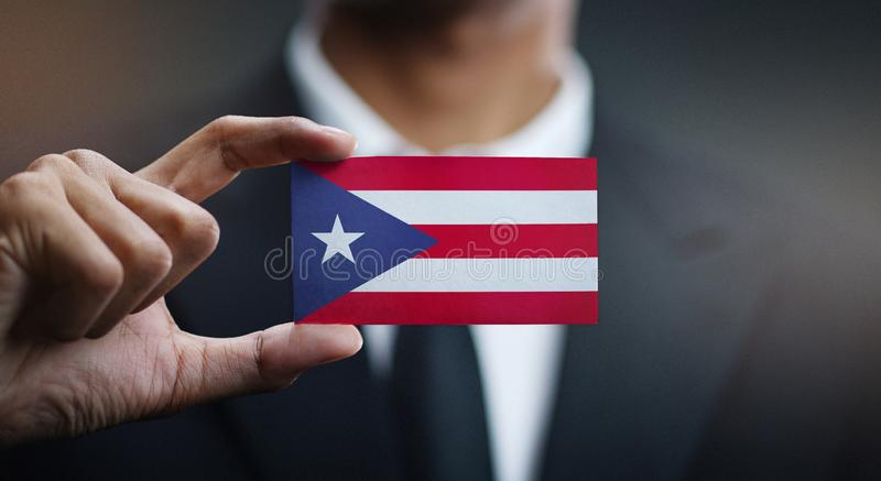 Businessman Holding Card Puerto Rico Flag royalty free stock images