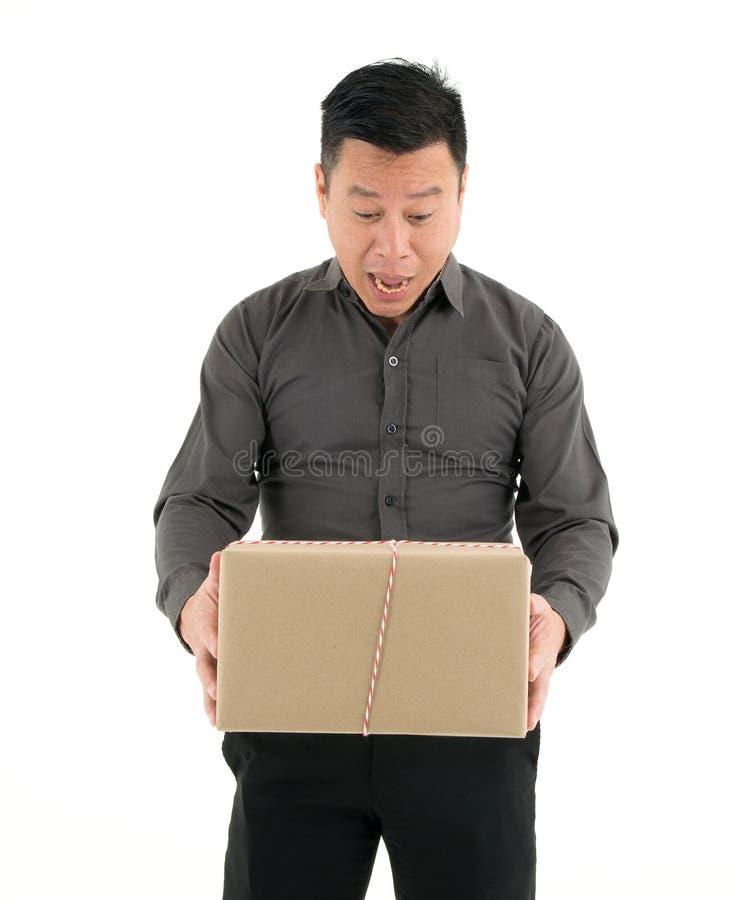 Businessman Holding Cardboard Box Isolated On White Background stock images